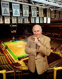 iconic photo of the boston celtics and nba legend red auerbach with the celtics championship banners and original parquet in the old boston garden