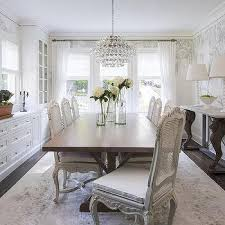 white french cane back dining chairs with walnut stained trestle dining table