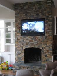 astounding stone fireplaces with tv over fireplace and bookshelves plus recliner and ottoman
