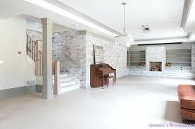 basement whitewashed brick walls hardwood flooring floor gray alabaster lantern crystal chandelier of whitewash floors