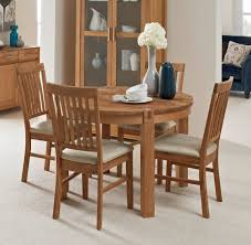 living homes collection regis oak round extending dining table 4 fabric chairs