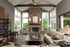 living room with stone fireplace. stacked stone fireplace with wood mantle living room contemporary exposed beams trim