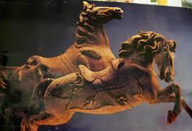 unpainted refurbished wood carvings of carousel horses