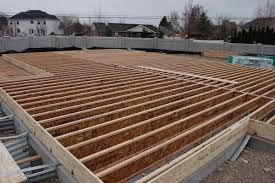 How to build a concrete house Cinder Block Picture Of Cut And Install The Floor Joists Between The Rim Joists Instructables How To Build Floor For House 11 Steps with Pictures