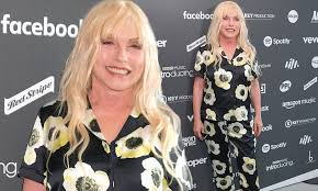 <b>Debbie Harry</b>, 74, attends London music event in a quirky floral co ...