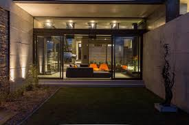 glass sliding doors garden exposed concrete wall luxurious modern residence in pretoria south africa