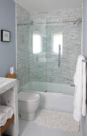 glass shower doors on bathtub bathroom