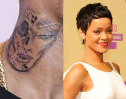 Is Chris Browns Neck Tattoo Of Rihannas Face Singer Shows Off Ink