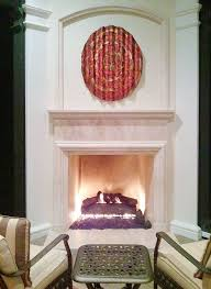 copper wall art over fireplace outdoors