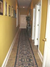 Hallways Decoration Idea With Picture On Along Yellow Wall And Carpet Along  Brown Floor Also White Doors And Lamp And Garnish Above Table - Use J/K to  ...