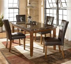 Lacey Rectangular Dining Room Table u0026 4 UPH Side Chairs by Signature Design  by Ashley Get your Lacey Rectangular Dining Room Table u0026 4 UPH Side Chairs  at