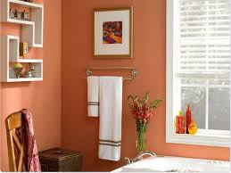 Sandy Coral Wall Color With Decorative Shelves For Small Bathroom ...