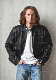 young long haired guy in leather jacket stock photo images