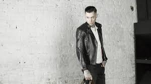 leather monkeys invictus classic leather cafe racer biker jacket worn by man with tattoo and long