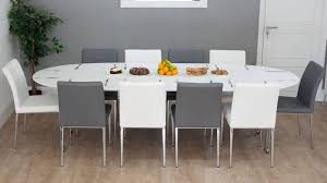 stylish white extending dining table and modern dining chairs