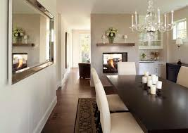 chic dining room features a george ii chandelier hanging over an espresso stained dining table lined with upholstered cream dining chairs facing a double