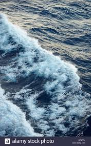 Ocean Wave Background Sea Wave View From Above In Blue Water Ocean Wave Background Stock