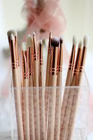 what gorgeous rose gold makeup brushes these are especially the ones with the white brush