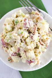 an overhead view of a plate of potato salad