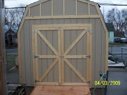 wooden storage shed with double doors from bird boyz builders a premier builder of wood storage