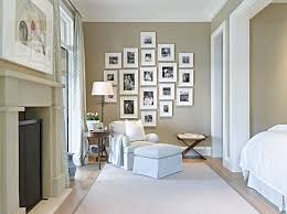 photo frame wall decor ideas bedroom transitional with picture grouping stone firep