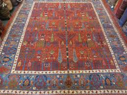 this is a new persian bijar carpet in an antique design tree of life design with