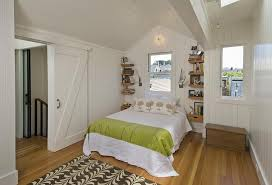 inspiration for a small contemporary guest bedroom in san francisco with white walls um hardwood