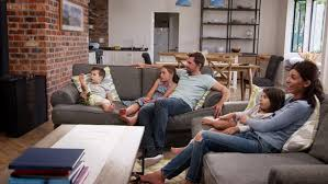 Family Sit On Sofa In Open Plan Lounge Watching Television - 4K stock  footage clip
