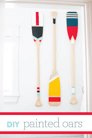 these painted oars are such a fun and easy diy i m always on the lookout for accessories and decor items for the lake house a few months back i d stumbled