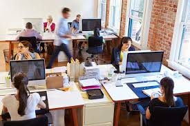 wide angle view busy design office. wide angle view of busy design office with workers at desks boldon james