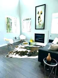cowhide rug in living room layered faux cow modern r cowhide rug
