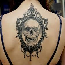 hand holding mirror tattoo. vintage skull tattoo hand holding mirror \