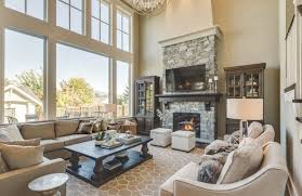 Two ottomans sit near a fire in this living room. These serve as great seats