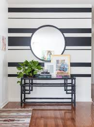 Striped painted walls Regard The Painted Stripes Give This Wall Of The Entryway Bold Touch Pinterest Holly Ryans Modern Vintage Mix Home Interior Walls zidovi