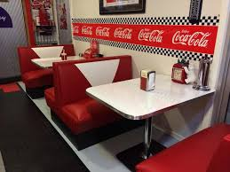 another picture of coca cola themed retro booths and tables