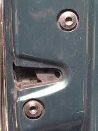 the only part of the door locks that is visible is the latch mechanism that hooks onto the u latch on the b pillar