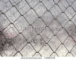 transparent chain link fence texture. Metal Chain-link Fence On A Background Of Transparent Grass Close-up Chain Link Texture L