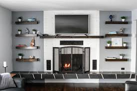 floating shelves next to fireplace