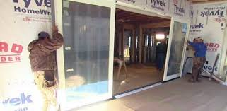 installing sliding glass door unit on kuppersmith project house today s homeowner