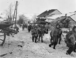 best battle of the bulge images the american troops of the third army commanded by general george patton moving through the belgian town