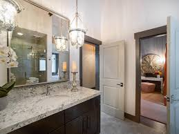 traditional bathroom lighting. Traditional Bathroom Lighting Ideas In A With Luxury Cabinets Plus Granite Countertop And Large Mirror On The Wall Doors