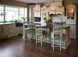 classic and antique white kitchen cabinets design with chandelier and lighting medium