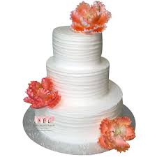 1654 3 Tier White Wedding Cake With Peach Colored Flowers Abc