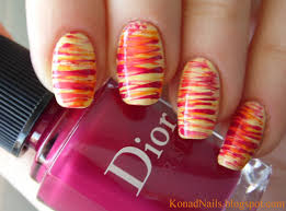 Konad Addict: Striped nail art using fan brush