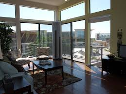Outstanding Sunroom Decor With Modern Furnishings And Wide Glass Floor To  Ceiling Windows As Sunroom Interior Loft Ideas