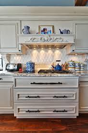 thermador cooktop kitchen mediterranean with dark floor distressed finish granite countertops kitchen hardware range