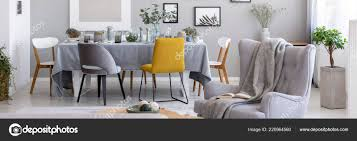 panorama blanket armchair chairs dining table grey living room interior stock photo