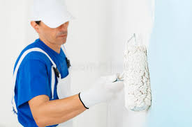 painter painting a wall with paint roller stock photo image of roller room