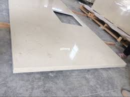 mitered edge beige quartz countertop