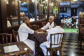 busy restaurant scene. Customers Wait For Orders At Cafe Irani Chai In Mumbai. India Has Long Been Dominated By Unbranded Eateries, Mainly Serving North Indian And South Busy Restaurant Scene